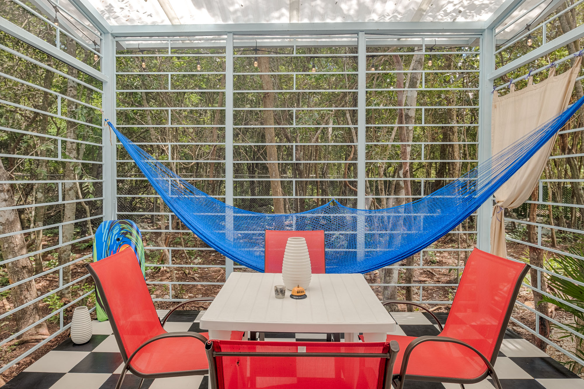 Birds chirping, butterflies dancing, you in the hammock relaxing